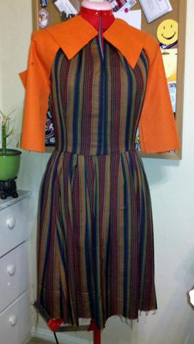 Pinned contrast to sewn part of striped dress