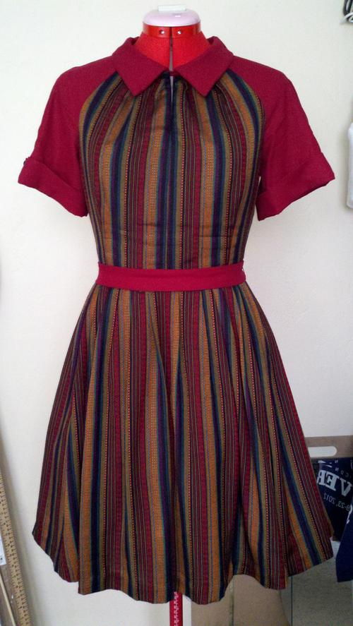 Front of fall colored striped dress on dressform