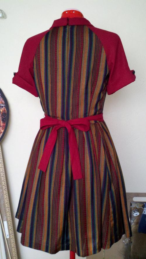 Back of fall colored striped dress on dressform
