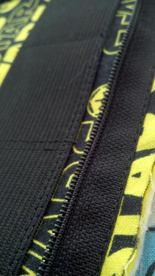 Close up of how close to the edge the stitch is on the zipper.